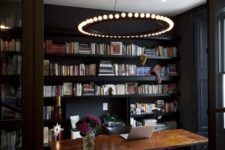 21 statement chandelier with bulbs makes this workspace rock