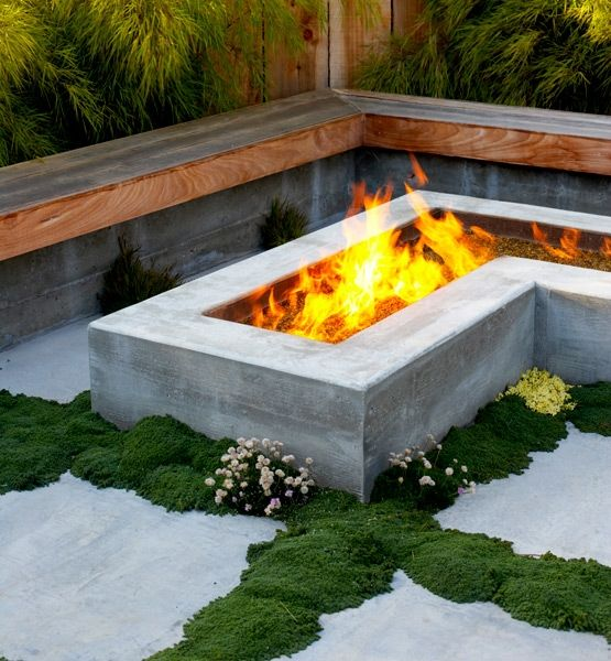 L-shaped wooden bench and L-shaped fire pit, moss to add a natural feel