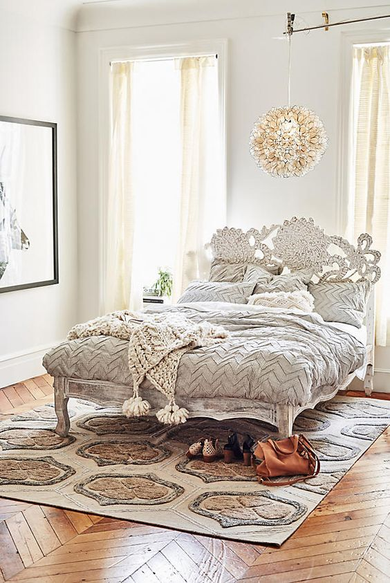 adorable shabby chic refined wooden bed with a carved headboard and legs