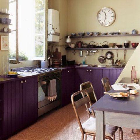 purple kitchen cabinets and creamy walls look interesting