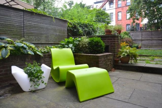 sculptural lime green chair with a foot rest for a minimalist space