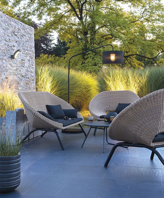 stylish rattan seat and chairs with black covers and cushions