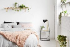 24 lots of plants here make the bedroom fresh and lively