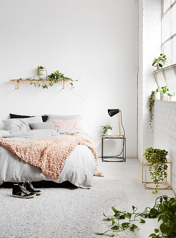 lots of plants here make the bedroom fresh and lively