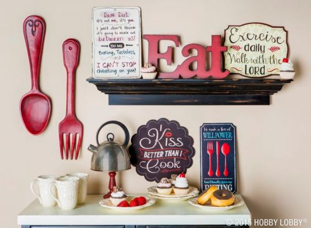 oversized red utensils, an EAT sign and some more wooden ones
