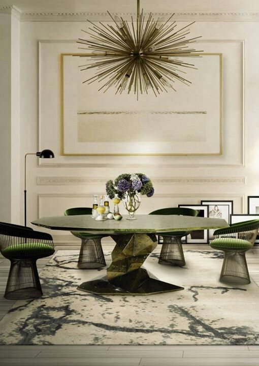 a sculptural table in the shades of green with a round top and a an eye-catchy leg
