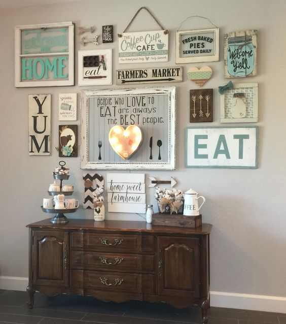 a whole shabby chic and rustic wall sign with lights to accentuate a drink station