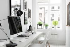 29 a modern and whitewashed office is made inviting with some modern pots