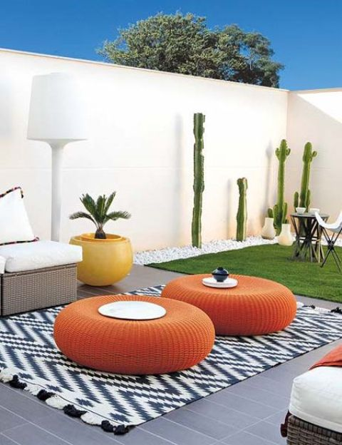 flat round wicker ottomans in bold orange