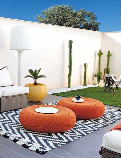 flat round wicker ottomans in bold orange