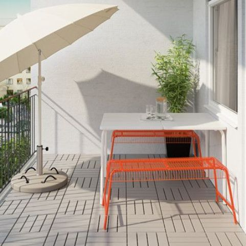VÄSTERÖN benches by Ikea in bold orange bring cheer to this space