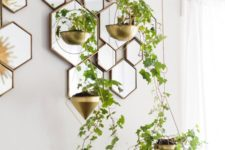 31 small gilded planters add a refined feel to the bedroom