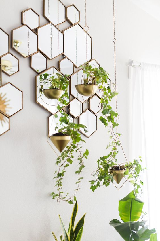 small gilded planters add a refined feel to the bedroom