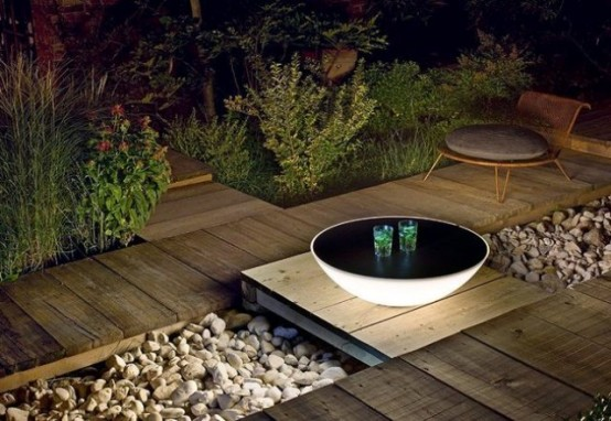 Terra solar lamps and tables by designer Jean Marie Massaud