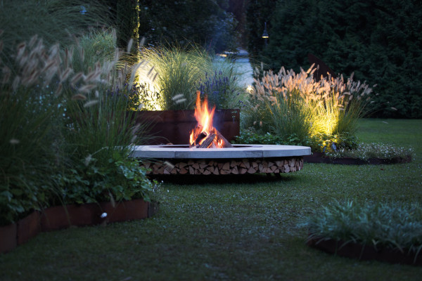 outdoor fire pit with firewood storage by AK47 (via design-milk.com)