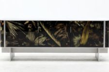 01 The console from Floral Noir collection has neutral framing and a gorgeous leaves in resin