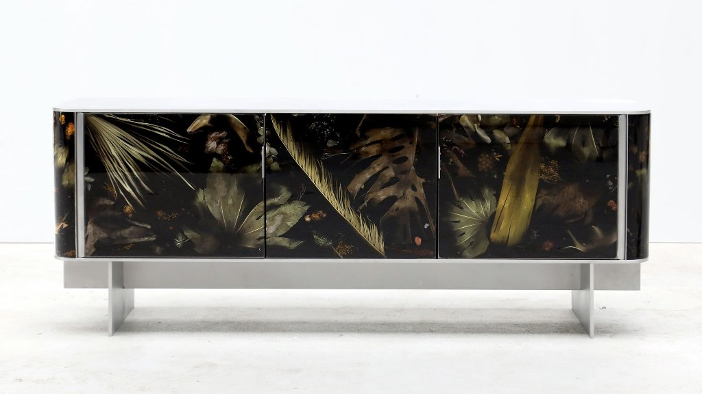 The console from Floral Noir collection has neutral framing and a gorgeous leaves in resin