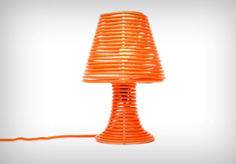 This Coil Lamp is made of an acrylic base covered with bold orange extension cord, which isn't only a part of lamp but also the design feature