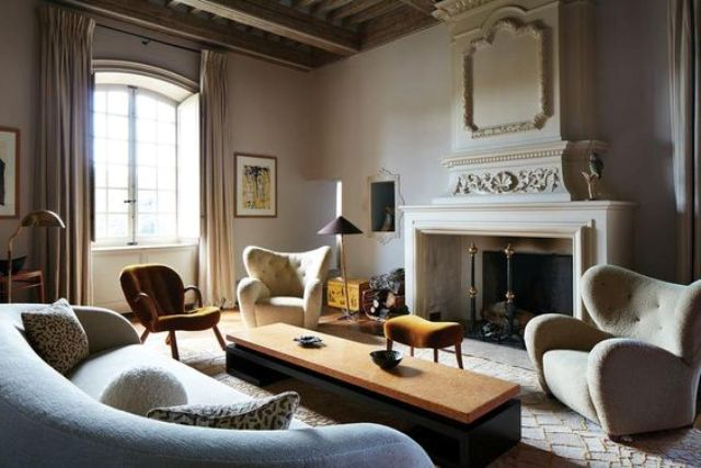 This beautiful french chateau was restored and furnished with cool designer items to create a chic