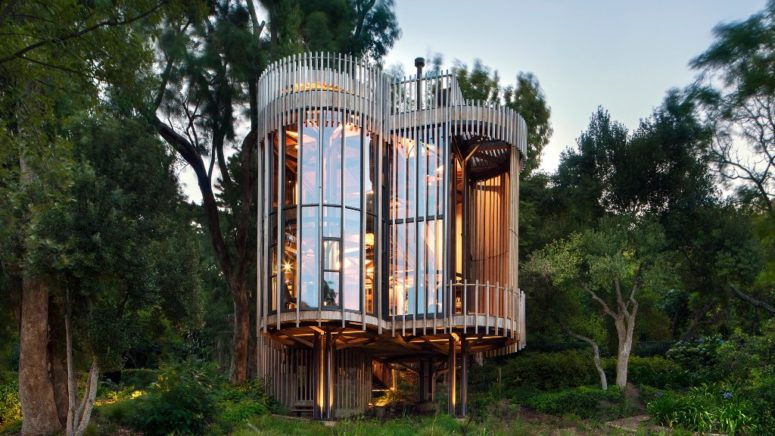 this unique house was made for a client who wanted a treehouse right in the forest