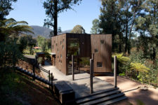 01 This vacation home clad with dark timber features a lot of piercings and glazings to bring the views inside and merge with nature