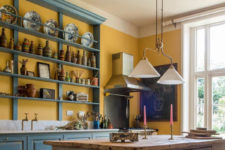 01 Vintage-inspired English country kitchen is done in unusual colors – bold blue and sunny yellow and some creamy touches