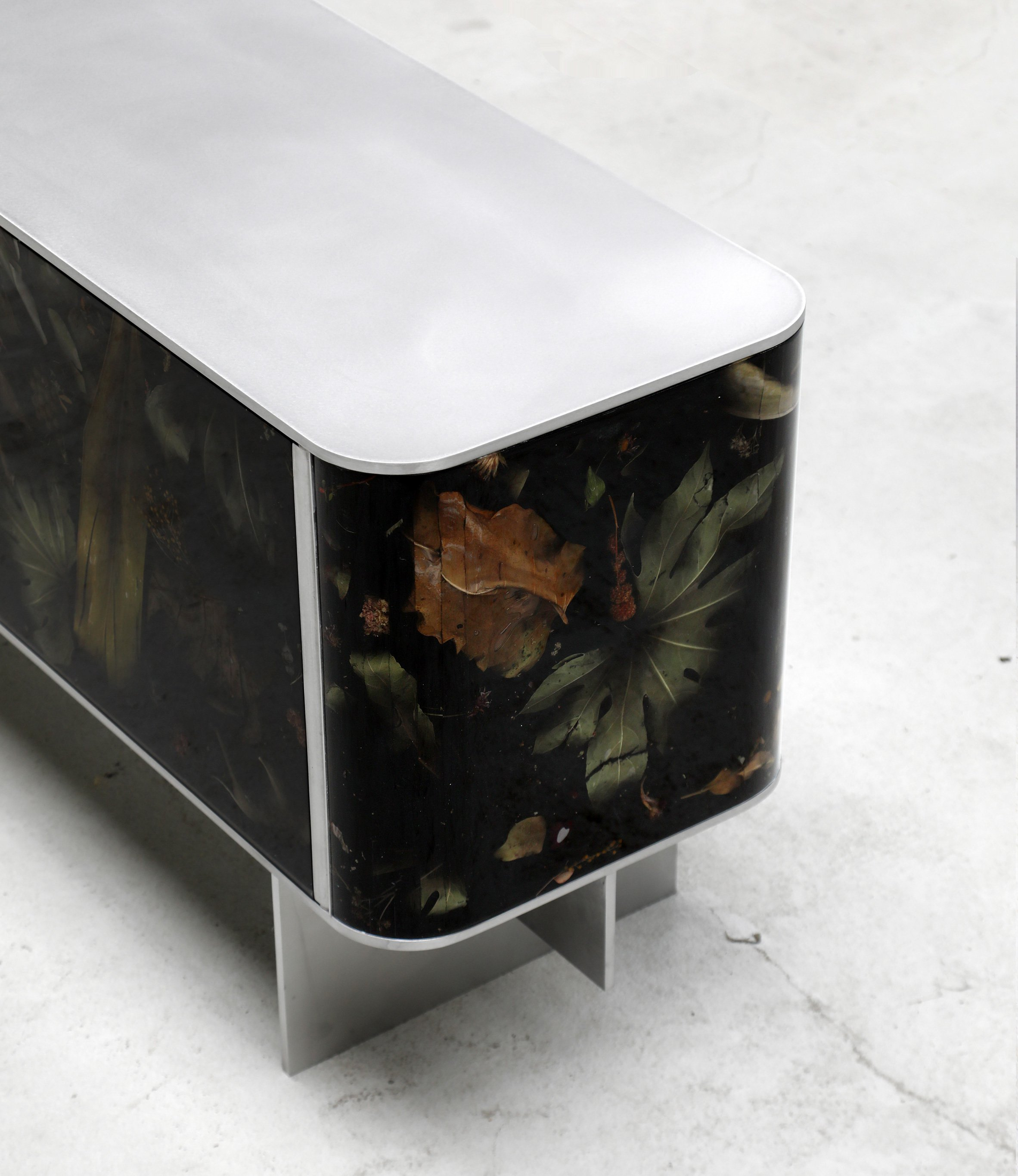 The contrast between coated steel and moody resin and flora parts is amazing