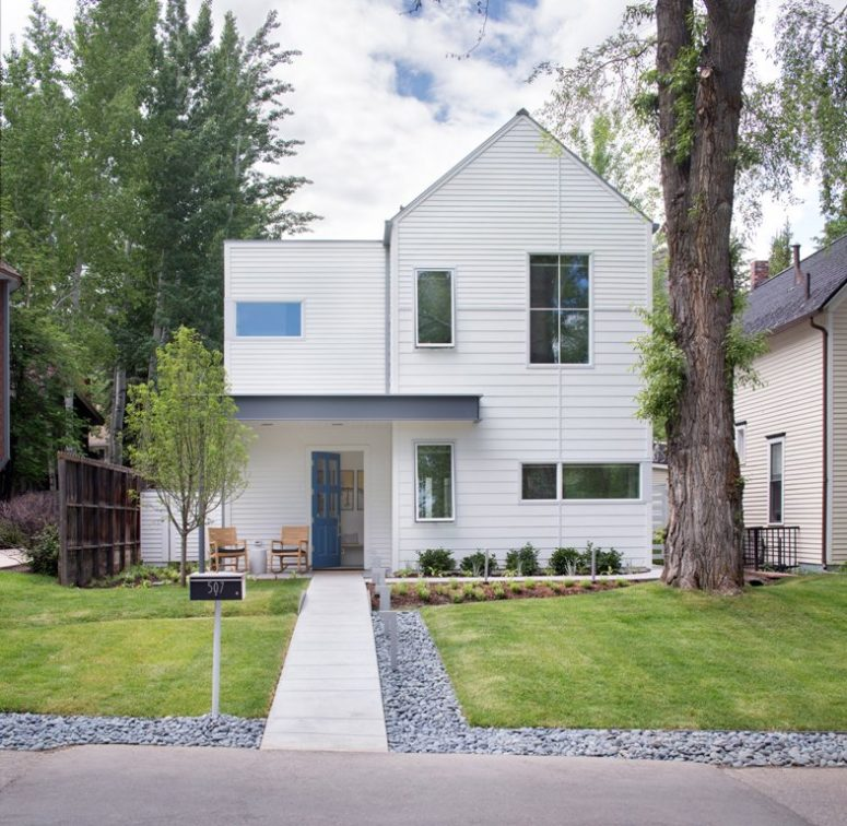The house has perfect landscaping and is covered with white siding to give it a more modern look