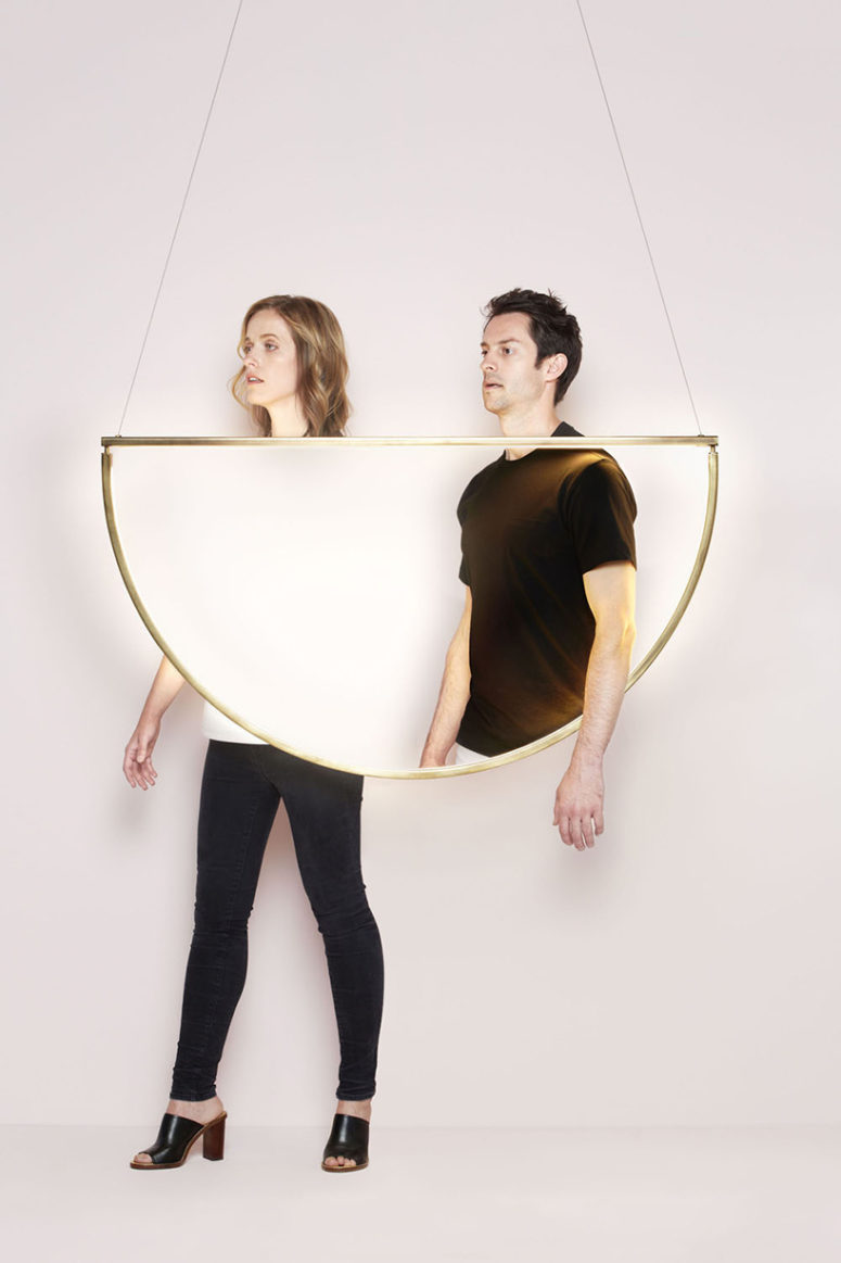 This lamp is a gilded framed semi-circle, though with a very simple yet cool modern design