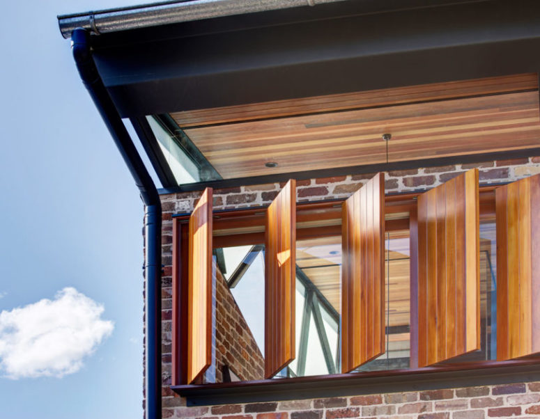 To soften the rough brick look, the designers used much warm-colored wood in the decor