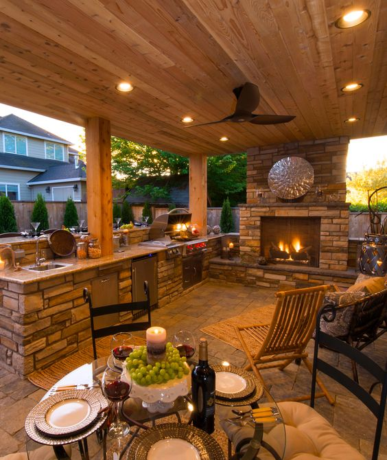27 smart ways to illuminate an outdoor space digsdigs a fireplace for light and coziness and small led lights over the whole kitchen and dining aloadofball