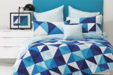 02 bold blue, navy and white triangle print bedding for a seaside space