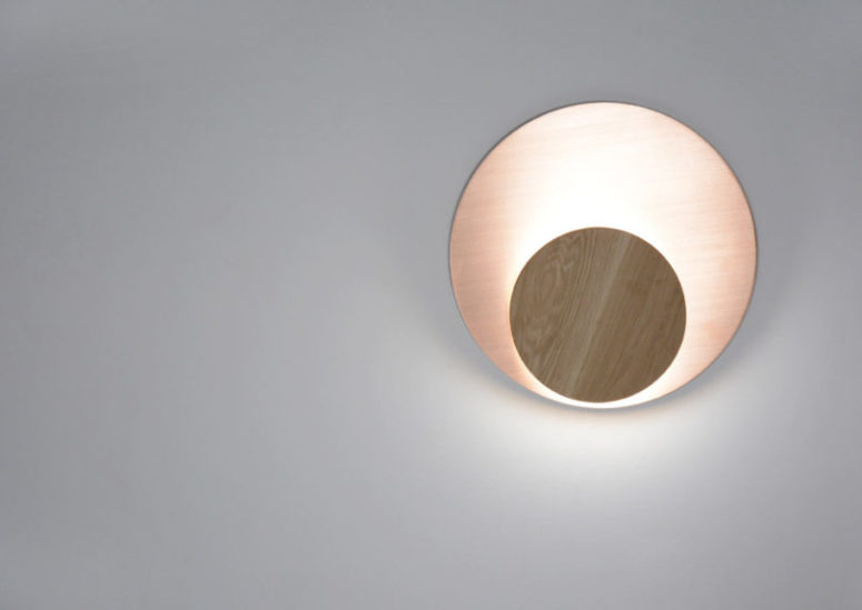 The circle can be in brushed copper or brass and the disk is only in solid wood of a contrasting shade