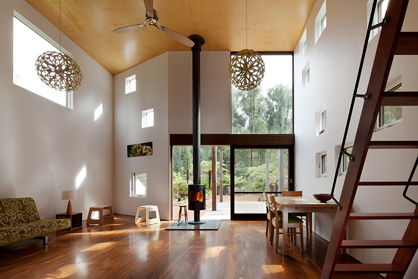 The hearth makes it cozier and warmer, and large carved pendant lamps highlight the super high ceilings