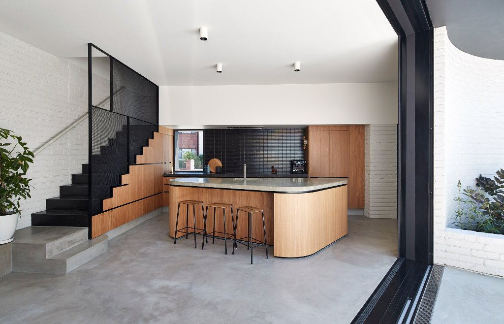 The inner decor is somewhat a blend of modern and mid century modern aesthetics, in white, black and natural wood