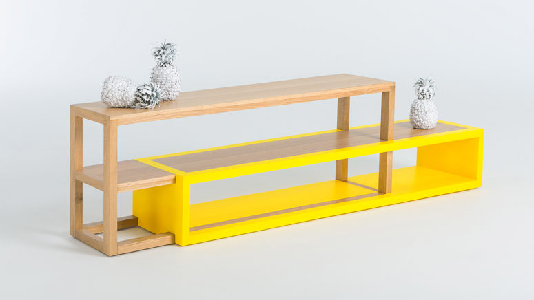 The media console creates an illusion of objects in motion thanks to the unique bold yellow part