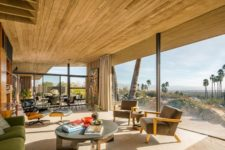 03 The stunning desert views are brought inside with a glazed wall, and they become a focal point of this interior