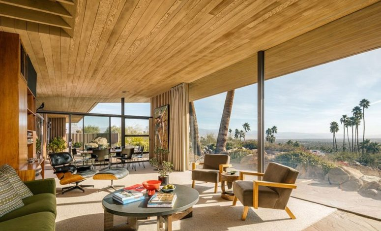 The stunning desert views are brought inside with a glazed wall, and they become a focal point of this interior