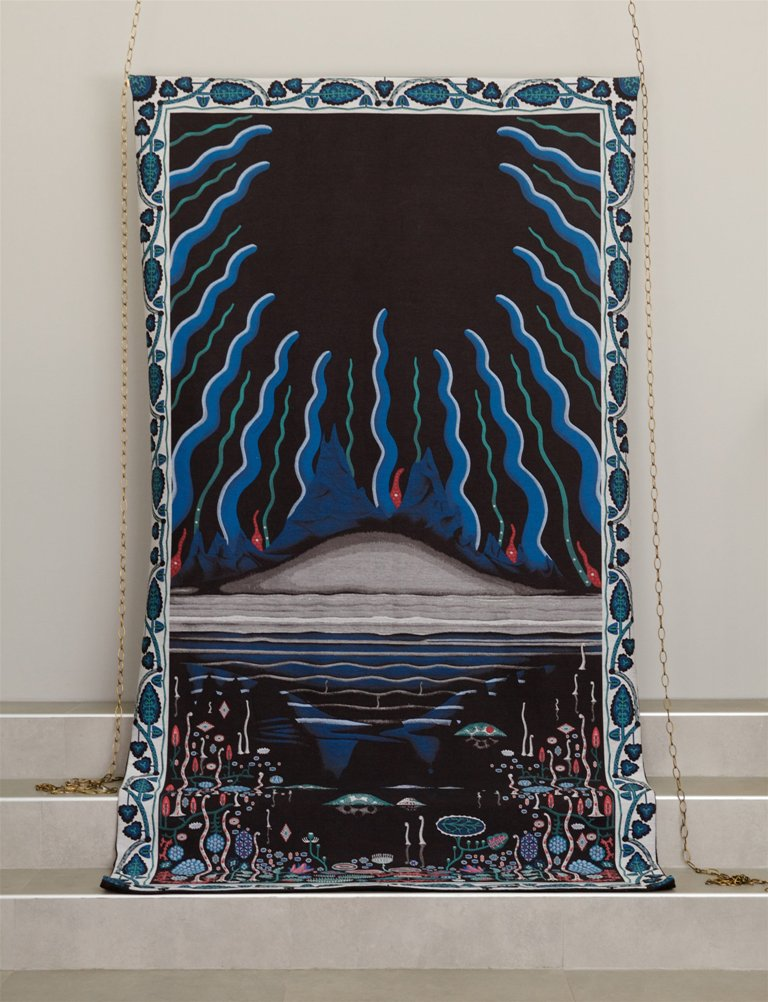 The tapestry is intended to be used as a rug over the sofa