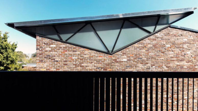 The trusses used at the rear of the house were inverted to form the low, sloped roofline