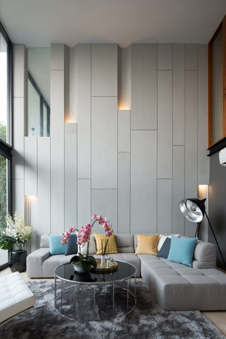 These off-white panels with light look super modern and unusual, this is a real focal point of the room