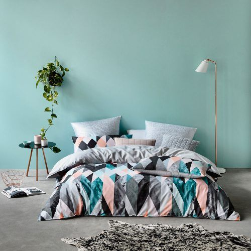 bold triangle duvet and pillows and calm pastel ones for more comfort
