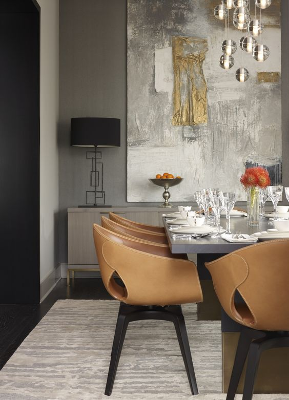 brown leather chairs on black wooden legs add texture to the space