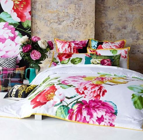 colorful oversized floral print bedding for a modern bedroom