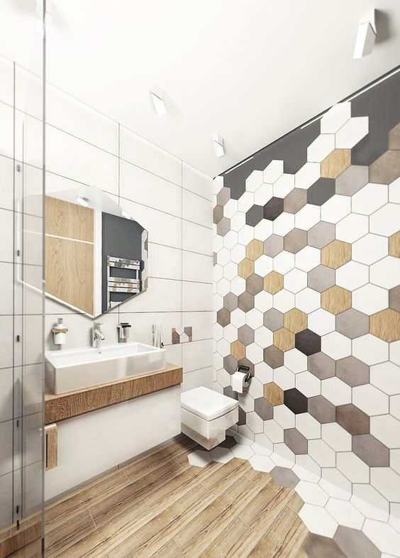 hexagon tiles in different shades and a transition into wooden floors look really eye-catching