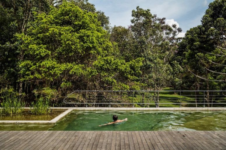 A pool is raised off the ground for better views over the surroundings