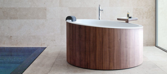 bathtub with a wood siding
