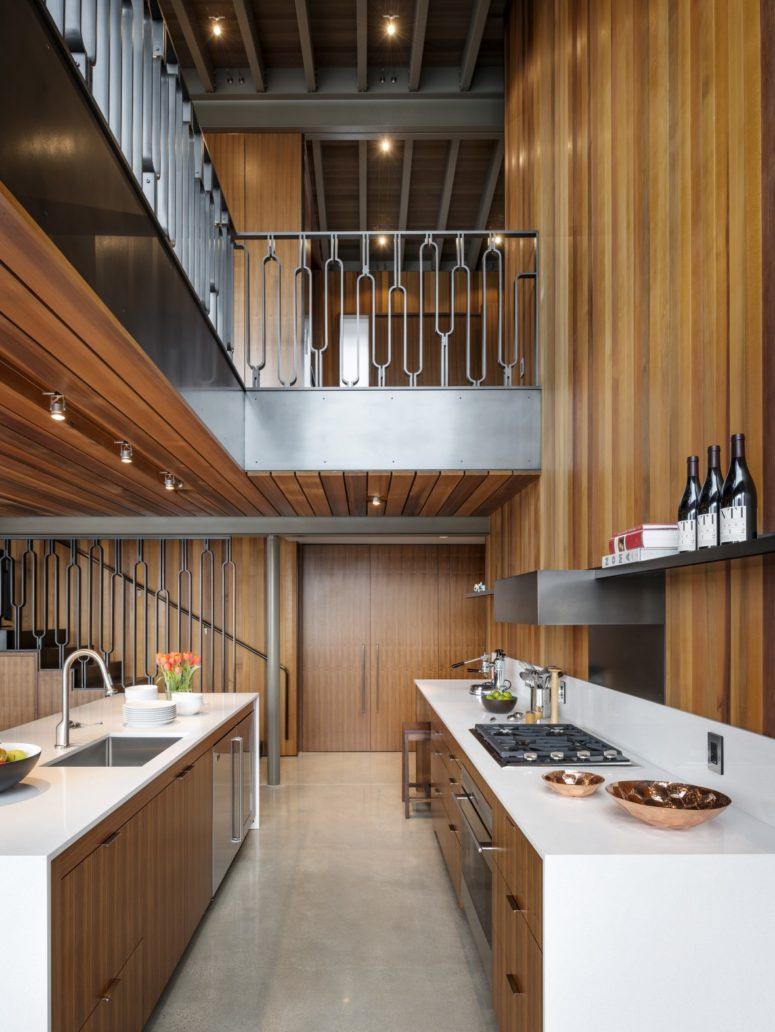 The kitchen is done in warm wood and sleek white for a contrast, the shelving is open