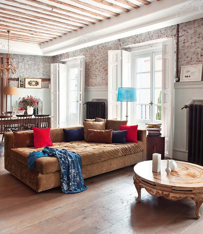 The sofa is comfy and inviting, and the coffee table is very exquisite, with carved legs