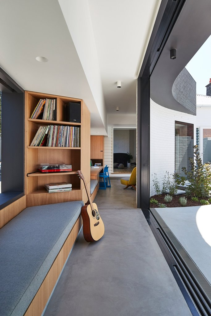 There's a corridor that functions as a reading nook and opens to the courtyard